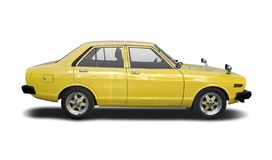 Classic Japanese Nissan Sunny side view isolated on white. Yellow classic Japanese sedan family car isolated on white stock photos