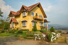 Yellow classic Mountain house Royalty Free Stock Photo