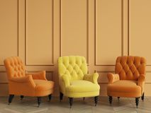Yellow classic tufted chair among orange chairs are standing in an empty room with copy space. Orange walls and floor parquet oak Herringbone. Digital Royalty Free Stock Photo