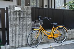 Yellow classical bicycle parked on the street Royalty Free Stock Image