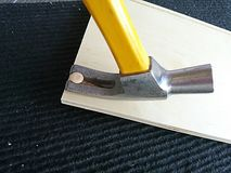 Yellow claw hammer Royalty Free Stock Image