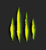 Yellow claw scratch marks on black background stock photo