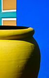 Yellow clay jar II. Yellow clay jar on a blue background Royalty Free Stock Image