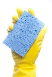 A yellow cleaning glove with a sponge Royalty Free Stock Photo