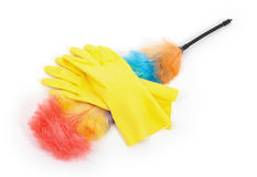 Yellow cleaning gloves with a duster Royalty Free Stock Photography
