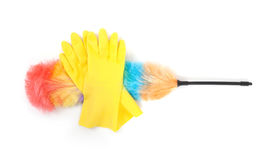 Yellow cleaning gloves with a duster Royalty Free Stock Images