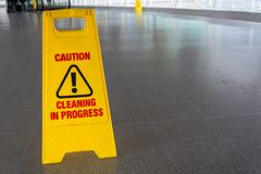 Yellow cleaning in process sign on the floor stock images