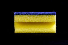 Yellow cleaning sponge black background Stock Photos