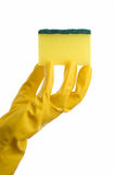 Yellow cleaning sponge and hand Royalty Free Stock Image