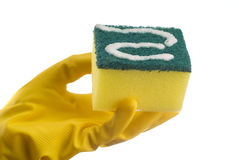 Yellow cleaning sponge and hand Stock Photo