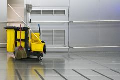 Free Yellow Cleaning Trolley Park In Walkway On Stainless Wall Backgr Royalty Free Stock Photos - 127283578