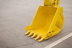 Yellow clear excavator bucket Stock Photography