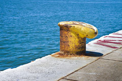 Yellow cleat for mooring boats Stock Photo