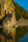 Yellow cliff over calm river Royalty Free Stock Image