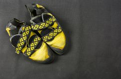 Yellow climbing shoes. Yellow black climbing shoes fastened with hook-and-loop fasteners Royalty Free Stock Photo