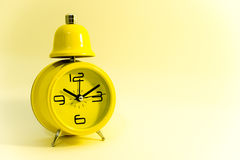 Yellow clock Stock Image