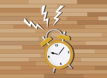Yellow clock deadline with wood background Royalty Free Stock Image