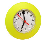Yellow clock isolated. Yellow plastic clock isolated in white background Stock Photos