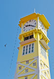Yellow clock tower with blue sky Royalty Free Stock Photos