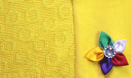 Yellow cloth with  stitched  flower Royalty Free Stock Photos