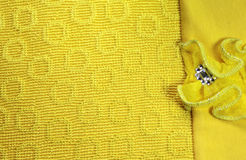Yellow cloth with  stitched  flower Stock Photography