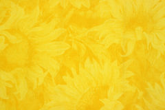 Yellow cloth with sunflower floral design Stock Photos