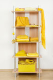 Yellow clothes nicely arranged on a shelf. Royalty Free Stock Photos