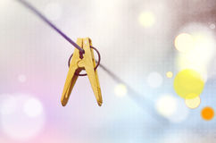 Yellow clothes peg on a washing line. Closeup of Colorful clothes peg on a rope on light background stock images