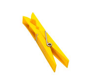 A yellow clothespeg. Isolated on a white background Royalty Free Stock Image