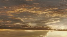 Dramatic sky with yellow clouds fly at morning during sunrise. Time lapse stock footage