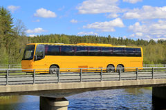 Yellow Coach Bus on Scenic Bridge Royalty Free Stock Image