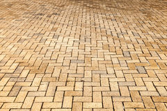 Yellow cobblestone road pavement, background. Photo with selective focus Stock Photography