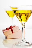 Yellow cocktail with gift box Stock Images