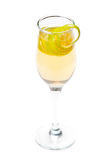 Yellow cocktail in glass with lemon twist Royalty Free Stock Image