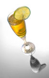 Yellow cocktail in glass with lime Royalty Free Stock Image