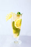Yellow cocktail with lemon, ice and mint Stock Photo