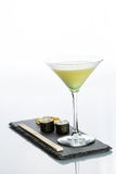 Yellow cocktail with a set of sushi on white Stock Photos