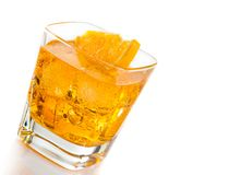 Yellow cocktail tilted with orange slice isolated on white background Stock Photography