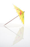 Yellow Cocktail Umbrella With Full Reflection Stock Photos