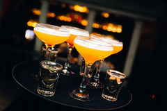 Colourful cocktails served in nightclub with nice bokeh royalty free stock photography