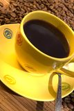 Yellow coffee cup Royalty Free Stock Images