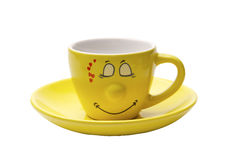 Yellow coffee cup. Ridiculous yellow coffee cup with a smile and heart Royalty Free Stock Photography