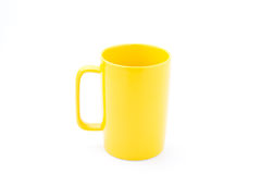 Yellow coffee cup. Isolated with white background Royalty Free Stock Photo