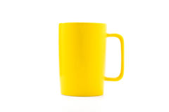 Yellow coffee cup. Isolated with white background Stock Photo