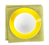 Yellow coffee cup over kitchen towel Stock Photos