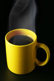 Yellow coffee cup with steam Royalty Free Stock Image