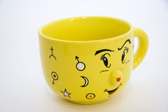 Yellow coffee cup Stock Photos