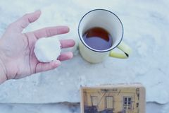 Yellow coffee mug in snow royalty free stock images