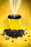Yellow coffee mugs and coffee beans Royalty Free Stock Photo