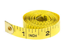 Yellow coiled tape measure on white Stock Photos